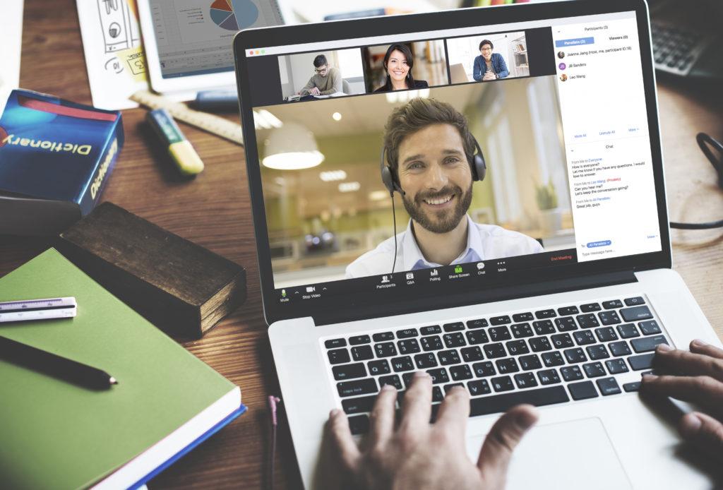 Man using Zoom Videoconferencing